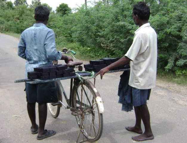 Transporting Indigo dye by bike, India, 2007. Photo by Mary Lance