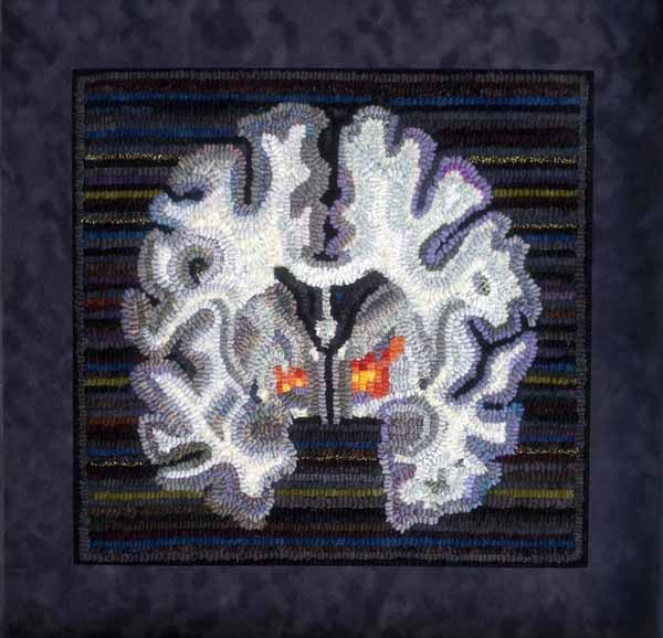 """Marjorie Taylor """"Warm Glow"""" (showing the brain activation that underlies altruistic behavior) 2013. Rug hooking. Photo courtesy of the artist."""