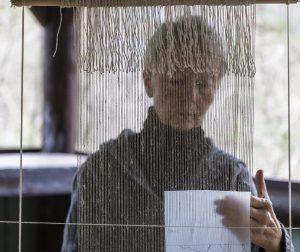 Tommye McClure in process weaving