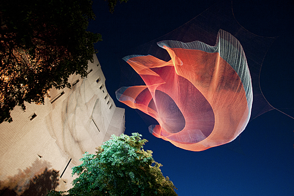 "Janet Echelman ""1.26"" 2010, 230? x 63? x 30?, installation view at the Biennial of the Americas, Denver, Colorado, Spectra® high-tenacity polyester fiber and lighting, machine knotting. CREDITS: Sponsoring Agency: Denver Office of Cultural Affairs. City Project Coordinator: Kendall Peterson, DOCA; Chris Jahn, Fuse Studio Architects. Studio Echelman Team: Mark Drummond Davis (Project Manager), Melanie Rose Peterson (Design, Prototyping), Rachel Kaede Newsam (Design Support), Andrew Edman (Design Support), Beckey Borlan (Prototyping). Engineer of Record: Charles Keyes, Shane McCormick, Martin/Martin Consulting Engineers. Design Engineer: Peter Heppel, Peter Heppel Associates. NASA Scientists: Richard Gross, Jet Propulsion Laboratory. NOAA Scientist: Christopher Moore, Center for Tsunami Research. Installation Management: Mike Mancarella, Junoworks. Lighting Designer: Joseph Gann, Richter Scale Productions. Donor of Spectra® Fiber: Honeywell, Inc. Book DesignerL Peter Bergman. Book Essay Author: Sanford Kwinter. Photo: Janet Echelman."