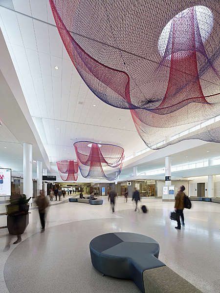 "Janet Echelman ""Every Beating Second"" 2011, total area about 15,000 sq. ft. (28.5? x 83.5? x 176.5?), installation view at San Francisco International Airport, powder-coated steel, colored fiber, skylights, terrazzo floor, and computer-programmed airflow and colored light, braiding, knotting, netting. CREDITS: Studio Echelman Team: Becky Borlan (Project Manager, Color Specialist, Photographs), Daniel Lear (Design Support), Philip Speranza (Design Support), Melanie Rose Peterson (Design Support), Yan Yan Mao (Photographs, On-site net fabrication), Rachel Kaede Newsam (Design Support). Architect for Art: Public Architecture & Planning (San Diego). Terminal Architecture: Gensler (Los Angeles). Engineer: Buro Happold (New York). Design Engineer: Peter Heppel Associates (Paris). Consultants: Speranza Architecture (New York). Lighting Design: Lam Partners (Cambridge, MA). Programming Consultant: Zoll Design (Boston). Photo: BruceDamonte."