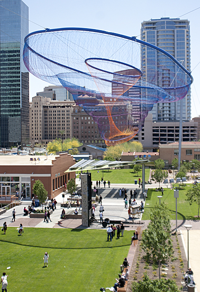 "Janet Echelman ""Her Secret is Patience"" 2009, 100? wide at top, 15? wide at bottom, painted and galvanized steel and cables; changing sets of recyclable high-tenacity polyester braided twine netting; colored lighting with computerized programming, hand and machine knotting. CREDITS: Client: City of Phoenix Office of Arts and Culture. Studio Echelman Team: Philip Speranza (Design Support), Melanie Rose Peterson (Conceptual Design/Development), Rachel Kaede Newsam (Design Support). Fabrication & Project Engineering: CAID Industries (Tuscon, AZ). Net Engineering: Buro Happold (New York). Aeronautical Engineering: Peter Heppel Associates (Paris). Consultant: Esperanza Architecture (New York). Steel Structure Engineering: M3 Engineering (Tuscon, AZ). Lighting: Vox Arts (Baltimore, MD). Structural Erection: Nexus Steel. Sculptural Foundations: Foresite Design (Berkley, MI). Photo: David Feldman."