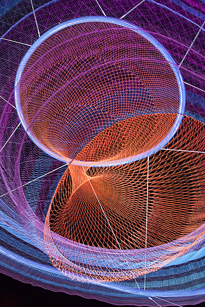 "Janet Echelman ""Her Secret is Patience"" Detail, 2009, 100? wide at top, 15? wide at bottom, painted and galvanized steel and cables; changing sets of recyclable high-tenacity polyester braided twine netting; colored lighting with computerized programming, hand and machine knotting. CREDITS: Client: City of Phoenix Office of Arts and Culture. Studio Echelman Team: Philip Speranza (Design Support), Melanie Rose Peterson (Conceptual Design/Development), Rachel Kaede Newsam (Design Support). Fabrication & Project Engineering: CAID Industries (Tuscon, AZ). Net Engineering: Buro Happold (New York). Aeronautical Engineering: Peter Heppel Associates (Paris). Consultant: Esperanza Architecture (New York). Steel Structure Engineering: M3 Engineering (Tuscon, AZ). Lighting: Vox Arts (Baltimore, MD). Structural Erection: Nexus Steel. Sculptural Foundations: Foresite Design (Berkley, MI). Photo: Janet Echelman."