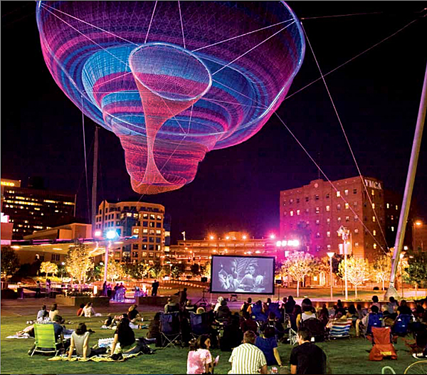 "Janet Echelman ""Her Secret is Patience"" 2009, 100? wide at top, 15? wide at bottom, painted and galvanized steel and cables; changing sets of recyclable high-tenacity polyester braided twine netting; colored lighting with computerized programming, hand and machine knotting. CREDITS: Client: City of Phoenix Office of Arts and Culture. Studio Echelman Team: Philip Speranza (Design Support), Melanie Rose Peterson (Conceptual Design/Development), Rachel Kaede Newsam (Design Support). Fabrication & Project Engineering: CAID Industries (Tuscon, AZ). Net Engineering: Buro Happold (New York). Aeronautical Engineering: Peter Heppel Associates (Paris). Consultant: Esperanza Architecture (New York). Steel Structure Engineering: M3 Engineering (Tuscon, AZ). Lighting: Vox Arts (Baltimore, MD). Structural Erection: Nexus Steel. Sculptural Foundations: Foresite Design (Berkley, MI). Photo Courtesy of Greater Phoenix."