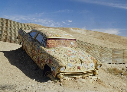"Betsabeé Romero ""Car/Ayate"" (at US-Mexico border) Cloth-covered auto painted with roses 169.3"" x 82.7"" x 55.1"",1997. ""InSite Biennial,"" Tijuana, Mexico. Daros Collection, Switzerland."