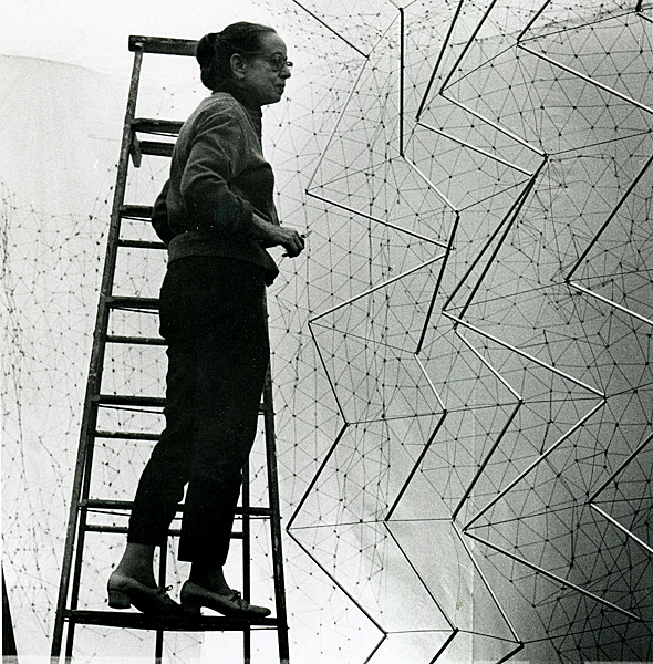 "Gego working on ""Reticularea (Ambientacion)"" (stainless steel wire, netted, dimensions variable) at the Center for Interamerican Relations Art Gallery, New York, in 1969. Photo: Ana Mari?a Castillo. ©Fundacion? Gego."