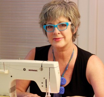 Rich Leisa headshot blue glasses sewing image