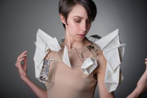 Lisa Klakulak & Sarah West Untitled Collaboration Merino wool, silk and cotton thread, steel, sterling silver, repurposed vinyl record; wet felted, hand and free-motion machine embroidered, brazed and soldered, heat formed and prong set (2016) photo: Becky Parker, model: Jaclyn Bowie