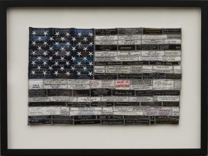"Michele Fandel Bonner Outsourced (2015) Recycled clothing labels and cotton/linen fabric, 14"" x 18.5"""