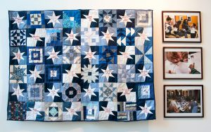 """Rachel Wallis """"Gone But Not Forgotten"""" 2014–ongoing, donated fabric, embroidery thread, quilting thread, batting, embroidery, appliqué, machine and hand quilting, currently 60"""" x 40' with an additional 80"""" panel to be added. Photo: Marcia Connolly."""