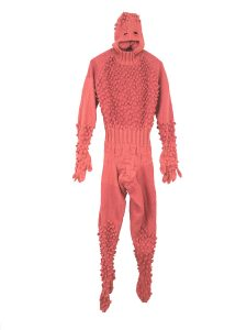 "Mark Newport Bobbleman (2006) hand knit acrylic yarn and buttons, 80""x23""x6"""