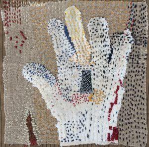 """Helen Geglio, """"Reach,"""" Found cotton glove, wool embroidery on linen, """"10"""" x 10"""" x 1.5,"""" 2019, website: www.helengeglio.com"""