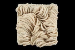 "Chris Motley, ""Family Vacation,"" Fiber; Hand-knit Wool fulled & sewn, 10"" x 10"" x 1.5,"" 2019, website: www.chrismotleyart.com"