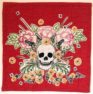 "Maggy Rozycki Hiltner. ""#1/Rozycki Hiltner/Memento mori: Handgun Violence,"" Hand-stitched cotton an found textiles, found quilt, ""10"" x 10"" x 0,"" 2019, website: www.maggyrhiltner.com"